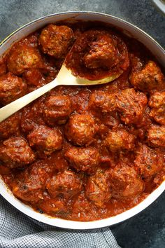 NYT Cooking: Tender meatballs filled with onions and Parmesan bathed in plenty of tomato sauce are classics in every way except for one: They call for turkey instead of the usual beef (or beef-veal-pork combination). Serve them over spaghetti or polenta Tomato Sauce Recipe, Sauce Recipes, Meat Recipes, Chicken Recipes, Cooking Recipes, Healthy Recipes, Yummy Recipes, Tomatoe Sauce, Cooking Games