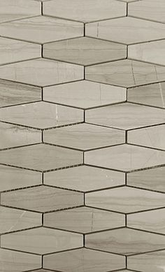 Rhombo Series | Eurotile.ca The Rhombo Series is a beautiful mosaic featuring an elongated hexagon pattern. Produced in 3 different natural stones: Basalt, Woodgrain Marble, and Bianco Carrara, our Rhombo series is ideal for a backsplash or a stunning feature wall.