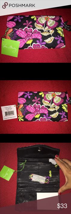 BNWT Vera Bradley quilted black/floral wallet BNWT Vera Bradley gorgeous floral perfect for fall trendy wallet. Quilted black with beautiful pink purple and tan flowers with green accents. Original price $49 has a strap included to turn it into a cross body purse!!! It has 14 card slots and 1 ID slot with 3 cash compartments and 2 outside zippers on the back with the Vera Bradley ribbons. Such a great piece for yourself or makes a great gift for a birthday or coming up on the holidays…