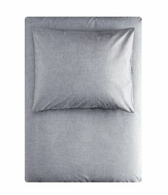 Duvet set in fine-threaded, closely woven cotton chambray in 40s yarn with a thread count of 190. The duvet cover fastens at the bottom with concealed metal press-studs H & M home