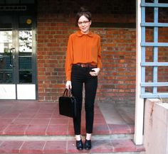 Love the blouse color, button up to collar, and high-waisted pants.