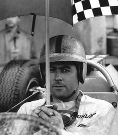 Brabham awaits the start of the very sodden German GP, the Nurburgring awash. He looks calm but it had been a fraught practice with the new car, the Climax V8 ran a bearing