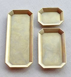 Brass trays by Even Cleveland.