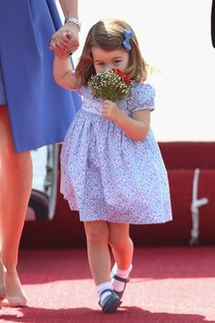 Princess Charlotte looked delighted with her flowers