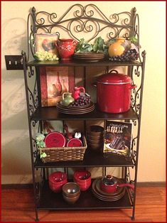 My New Bakers Rack❤ In My Kitchen/ Dining Room. Iron Decor Grapes and Vines Jars and Paula Dean CookWare good way to stay organized Red Kitchen Decor, Farmhouse Kitchen Decor, Country Kitchen, Kitchen Dining, Dining Room, Kitchen Ideas, Bakers Rack Decorating, Tuscan Decorating, Tuscan House