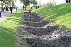 Gabion swale basket for water filtration and management.