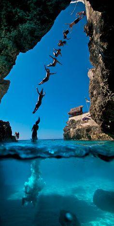 Cliff diving in Santorini, Greece