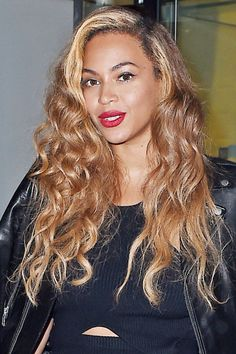 Beyonce opts for a bleach blonde streak to frame her face and balances it out with honey blonde strands.