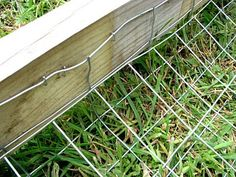 """Simple way to make a wood fence """"dig-proof""""."""