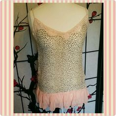 Leopard Print Top Women's sheer pink and leopard print tank top. Great Condition, no tags, but never worn. I love the combination of the mocha leopard brown with the peachy pink. Pair it with a great statement necklace or layer with some dainty gold chains around the neck. Great Condition. Venus  Tops Tank Tops