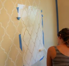 Stenciled wall. could do in the same color as wall with a high gloss paint.