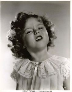 Shirley Temple - is she snorting, honking or just making a face?