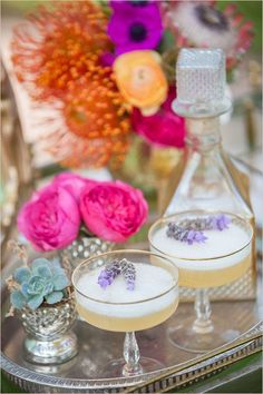 Lavender whiskey sour bride's drink. #weddingchicks Captured By: Lovato Images http://www.weddingchicks.com/2014/06/27/tea-party-for-two-engagement/