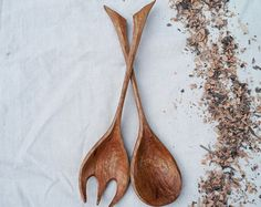 A matched wooden fork and spoon for serving salad, pasta or most anything. They are relatively large, 13 long by 3 wide, designed to be comfortable