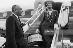 French fashion designer Coco Chanel says goodbye to American department store executive Stanley Marcus as she boards an airplane in Dallas, Texas. Chanel had been visiting for the opening of a new Neiman-Marcus store. She holds a package from the store.