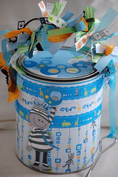 Altered paint can I made with scrapbook paper, embellishments and lots of ribbon.  I adore this zebra!