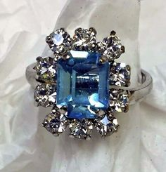 """Henkel & Grosss has manufactured jewelry for Christian Dior since 1955. Signed Christian Dior 1971 Germany. Showstopping Christian Dior Ring. features 1/4"""" turquoise colored glass stone and brilliant rhinestones all around.   eBay!"""