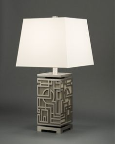 Boyd Lighting's Marlowe Table Lamp was designed by Alicia Cort. The sturdy, mid-size lamp is a modern interpretation of Chinoiserie meets Old Hollywood glamour. Available in five metal finish options and three rich wood color options. Can be pared with either a Warm White Silk shade or a Jet Black Linen shade with a matte gold liner. 30 possible finish combinations. Style: Asian, traditional, mid-century