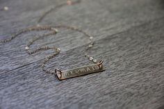 Make your story so beautiful, mermaids have trouble believing its true. -R.I.D.  I hand stamp this 14k gold filled horizontal mermaid bar necklace