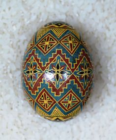 Slate grey and warm gold and earth hues make this chicken pysanka unique! Just listed at The Illustrated Egg. http://www.etsy.com/shop/TheIllustratedEgg