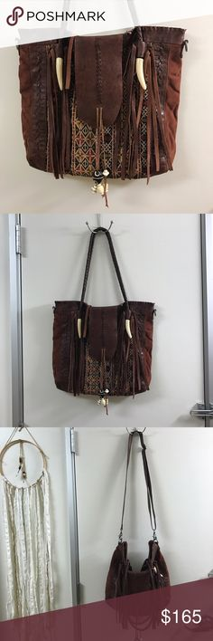 Free People Purse I've only used this once sadly. I doesn't match with my wardrobe. It is in the exact condition as when I bought it from the store. It is real leather. Free People Bags Totes