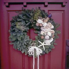 Bold & Beautiful: Spruce up a fir wreath with coastal character by adorning it with seashells and fishing lures. Hung on a broad red front door, the seasonal accent warmly welcomes all guests. Wreath available at home supply stores.