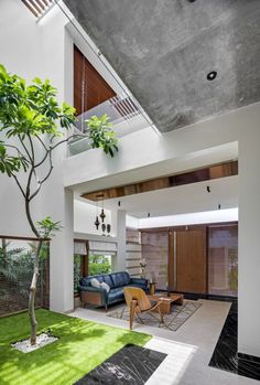 The Bungalow Has Striking Inclined Wall Which Adds Dynamism | Crest Architects - The Architects Diary Bungalow Exterior, Dream House Exterior, Cleaning White Walls, Indoor Courtyard, Outdoor Spaces, Outdoor Decor, Interior Decorating, Interior Design, Bathroom Design Small