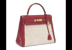 Hermes Kelly bag 1973 -- A red leather and toile 'Kelly' bag Hermes, 1973 Goldtone metal hardware, with padlock, keyfob and dustbag