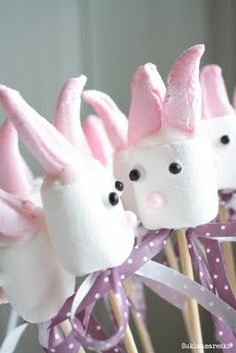 Marhsmallow Bunnies....these would be even better if they were dipped in white and pink chocolate!  :)  Yum!