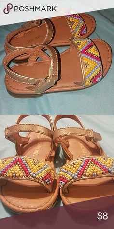 Bundle 2 pairs of Baby girl/toddler sandals Gold strappy sandals with colorful beads and white sandals with cute orange and pink flowers. Only defect are the small scuffs at the front which are pictured. Only worn for approx 3 months so barely any wear.  ****Please ask any and all questions before making an offer*** Cherokee Shoes Sandals & Flip Flops