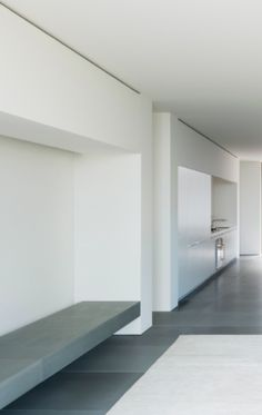 Pure interior, wall-mounted bench, the Picornell House in Mallorca, Spain by John Pawson _