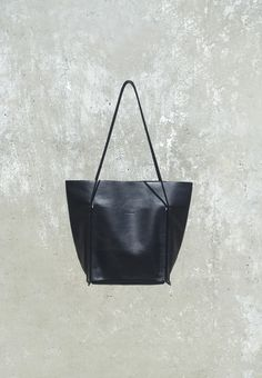 Pocket Tote a soft everyday tote bag 31 cm × 38 cm × 17 cm, strap drop 29 cm $460.00   Smooth Soft Black Leather, Rubber shoulder strap, Pockets on both faces