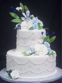 Vintage traditional ivory and blue buttercream piped wedding cake created by: Cakes by Mom and Me, LLC