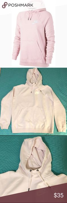 💕NWT NIKE HOODIE💕 Brand new! This is the Nike Heatherized Rally Hoodie. They are so comfortable! Soft and fuzzy on the inside. It's hard to tell from my pictures, but the color is a very soft pink.   Comes from a non smoking home!   Happy Poshing! 😘 Nike Tops Sweatshirts & Hoodies