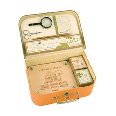 AWESOME Kids Botanist Kit! Comes with three specimen boxes for storing seeds and other findings, a natural wood flower press, a note book and pencil for recording information, small scissors, and magnifying glass.