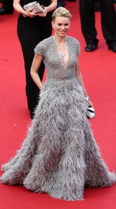 Naomi Watts accessorized her feather and sequin gray dress at Cannes Film Festival with a diamond cuff bracelet and amazing diamond necklace which fell into her plunging neckline.