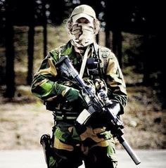 Norwegian Forsvarets Spesialkommando (FSK) or Armed Forces Special Command operator in a summer loadout.
