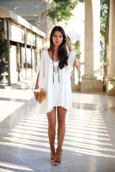 women's fashion- flowy white dress, statement necklace, heels