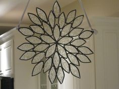Stained Glass flower or star Sun Catcher for the home or garden. $55.00, via Etsy.
