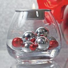 "CLEARLY CREATIVE TEALIGHT HOLDER : Fine hand-blown glass holder to fill with your own seasonal decorations. Finished with a metal candle dish to hold a tealight. 4""h, 4¼""dia. by PartyLite"