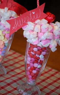 Candy Soda Glass Centerpiece- Start by filling any clear glass vase, parfait dish, or drinking glass with colorful Valentine's Day candy like candy hearts or cinnamon hearts. Then make a bouquet on the top of the display with salt water taffy or other soft candy. To hold the bouquet in place, stick a toothpick into each soft candy. For taller displays, you can use wooden skewers.