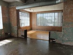 Exposed brick, concrete & hardwood floors, restored 1920s Cotton Gin building.
