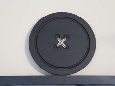 Can't forget the jumbo button wall decoration above my desk. That post was so popular. This is made from a cheese board!