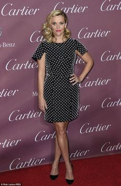 Looking chic! Reese Witherpoon donned a pearl-embroidered Michael Kors dress to accept the Chairman's Award at the Palm Springs Film Festival on Saturday
