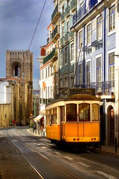 Lisbon - Tram going down close by the Cathedral, Portugal Otro lugar hermoso! Magic Places, Places To Visit, Lisbon Tram, Tramway, Spain And Portugal, Most Beautiful Cities, World Of Color, Pilgrimage, Day Tours