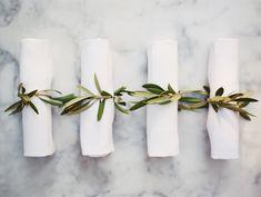greenery wrapped rolled napkins | modern elegant floral napkin treatment | Photography: Kurt Boomer - www.kurtboomer.com  Read More: http://www.stylemepretty.com/2015/05/14/romantic-minimalism-wedding-inspiration/