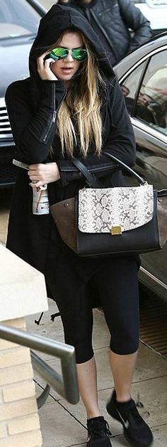 77d0331a7813 Who made Khloe Kardashian s gray print handbag