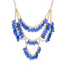Blue tiered bib necklace.