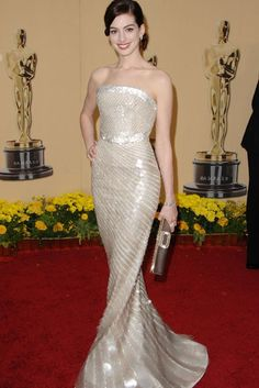 Anne Hathaway in an Armani Privé Spring 2009 gown, covered in glimmering paillettes (2009)