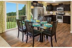 Sliding glass doors provide a view from this spacious kitchen and dining area. The Glenmont plan built by Centex Homes. The Hanover Trace community. Louisville, KY.